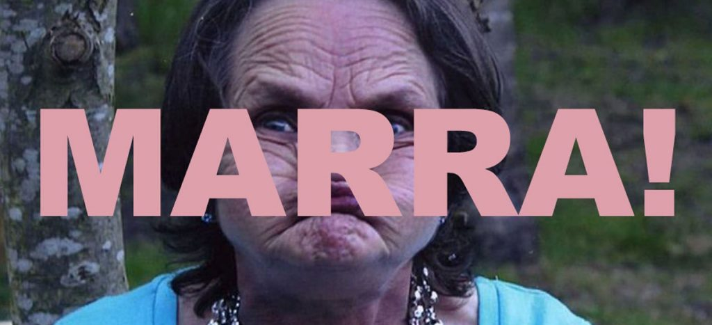 Promotional image for Lone Taxidemist's show Marra! which shows an older woman with a screwed up face overwritten with the word MARRA! in big pink letters