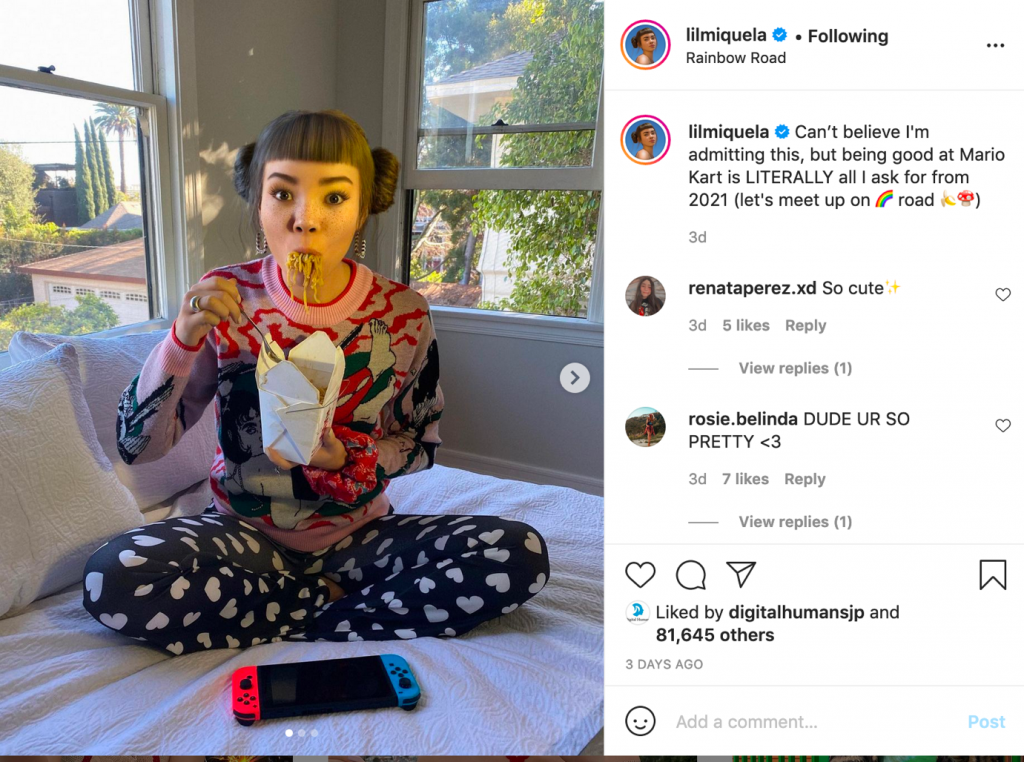 Instagram screenshot of Lil Miquela eating noodles cross-legged on her bed
