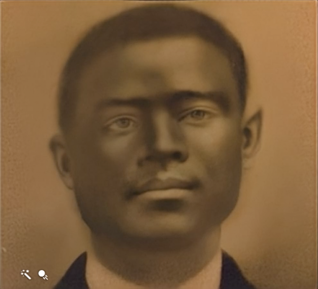 A sepia portrait of a man wearing a suit jacket and white shirt