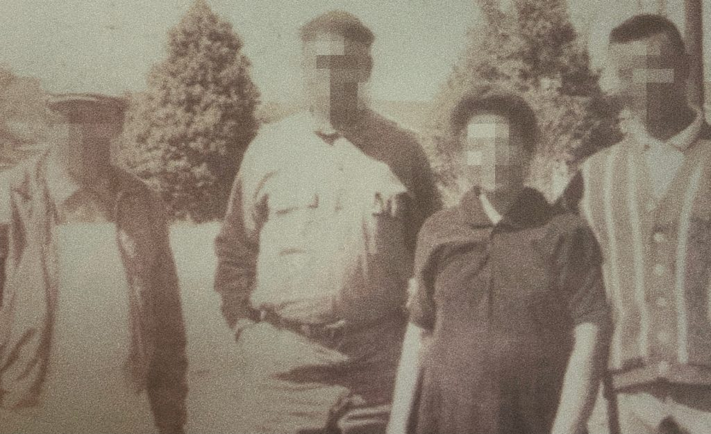A sepia photograph showing four members of Ashanti Anderson's family with their faces pixelated.